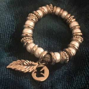 Gorgeous white & silver bracelet with dove